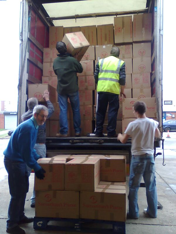 Loading the lorry with shoeboxes
