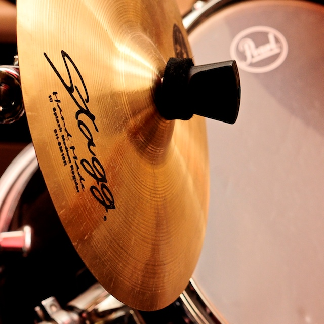 Close up of cymbals and drum kit