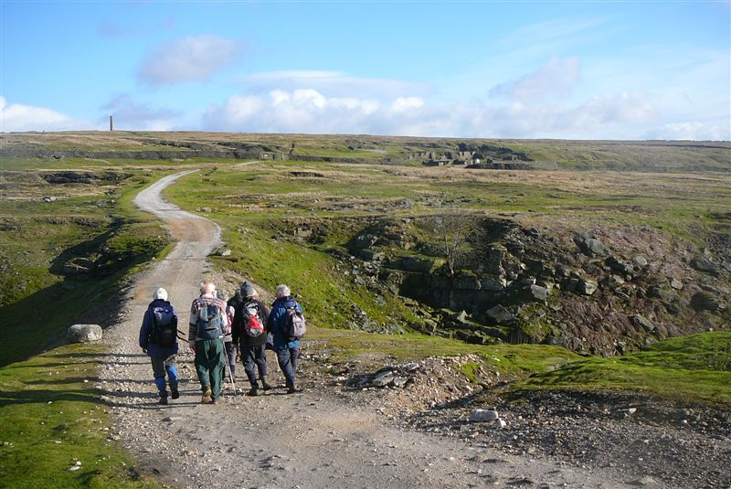Walkers on an old mine track above Grassington