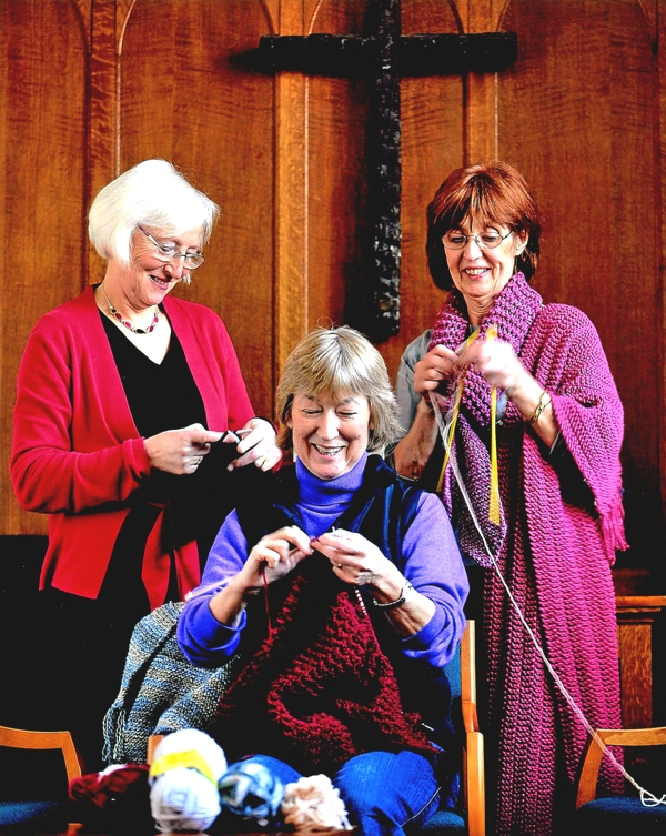 Three ladies knitting Shawls