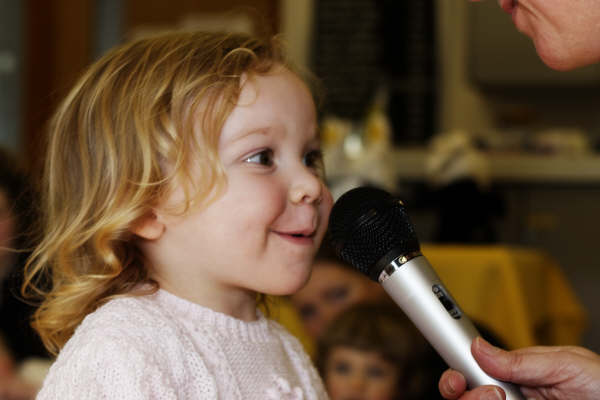 Rhythm Time child singing into microphone
