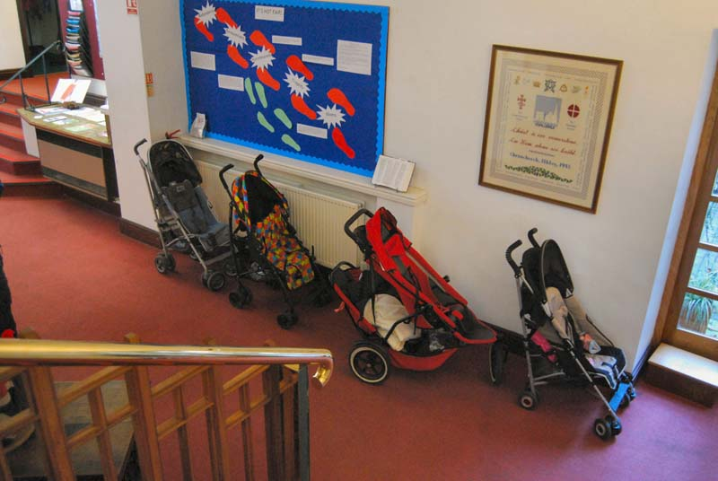 A queue of pushchairs in the Foyer