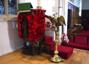 Knitted poppies on the pulpit.