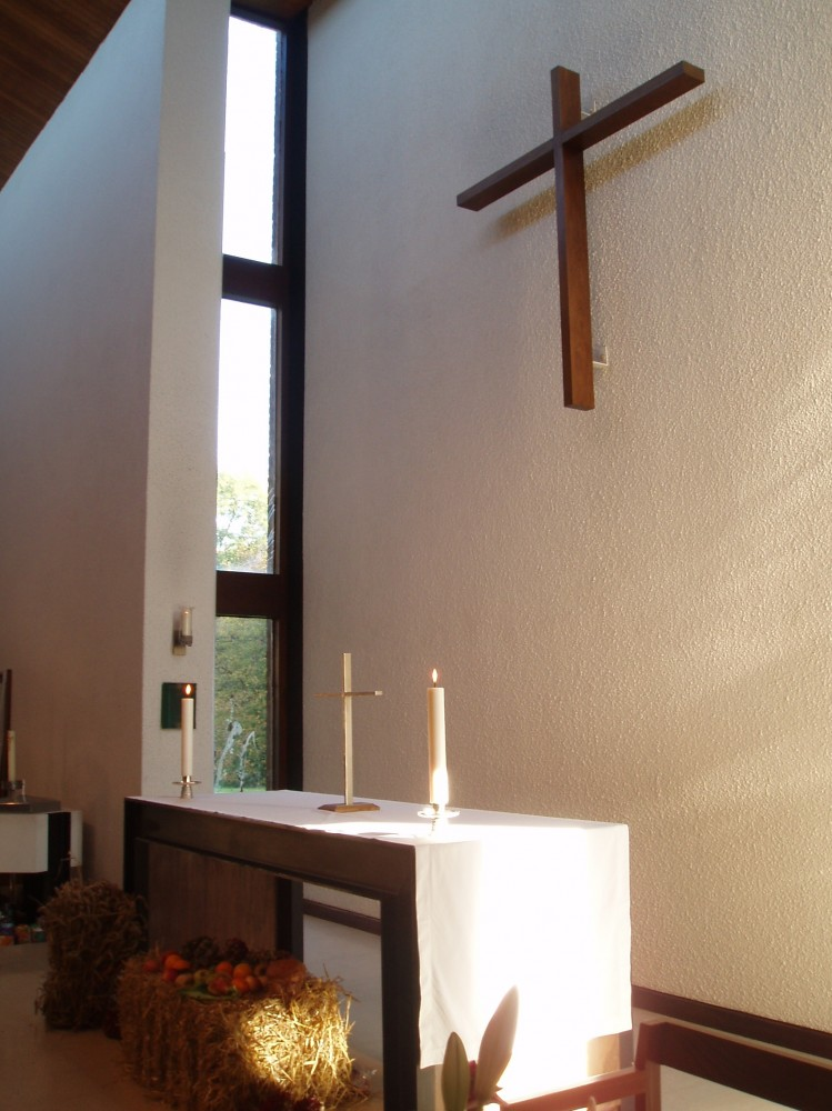 The altar  table and wall hung wooden cross