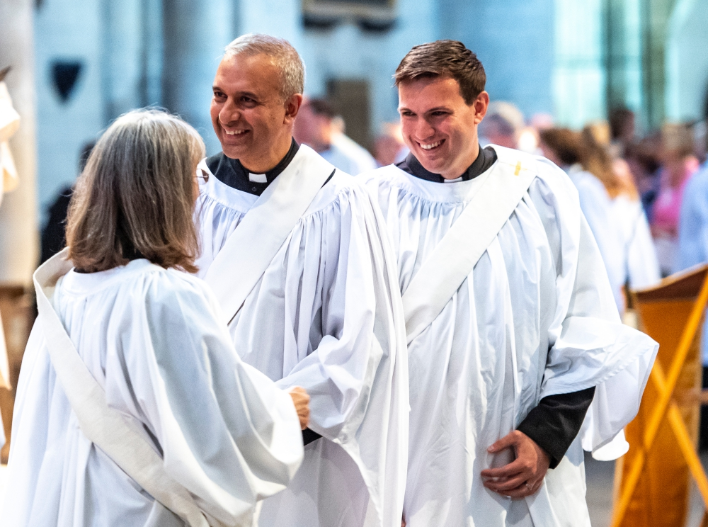 Two smiling male clergy at an ordination service