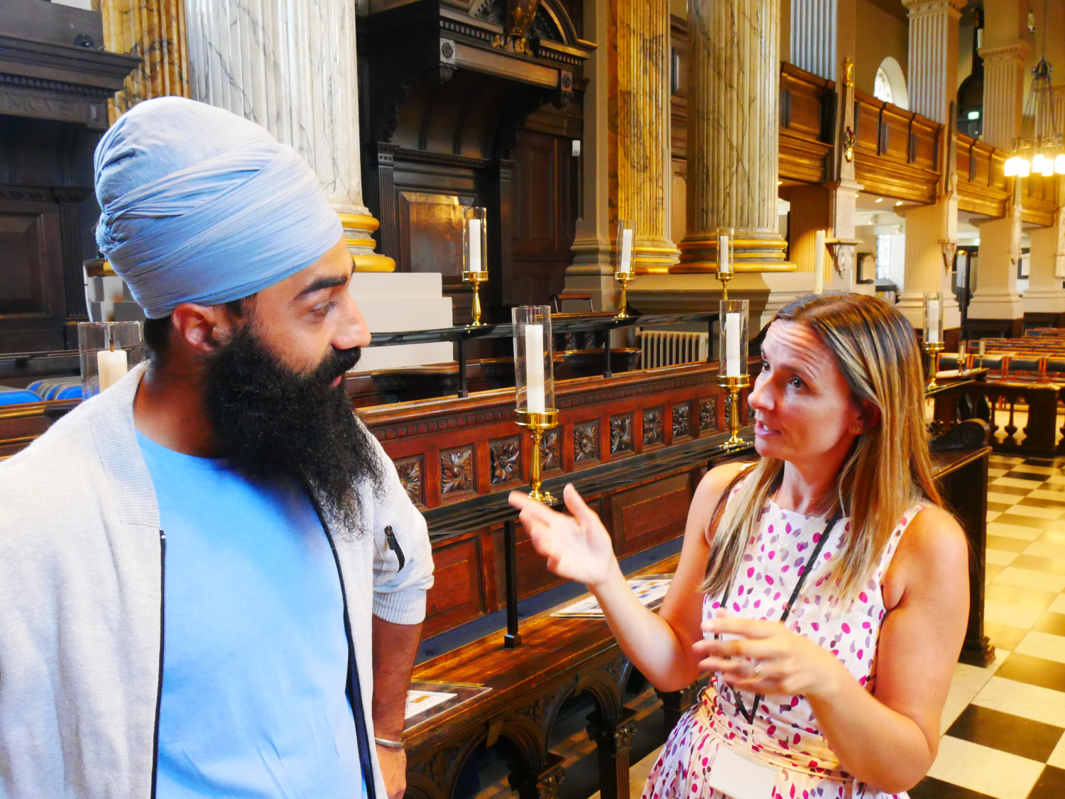 A Sikh man and a Christian woman talking together