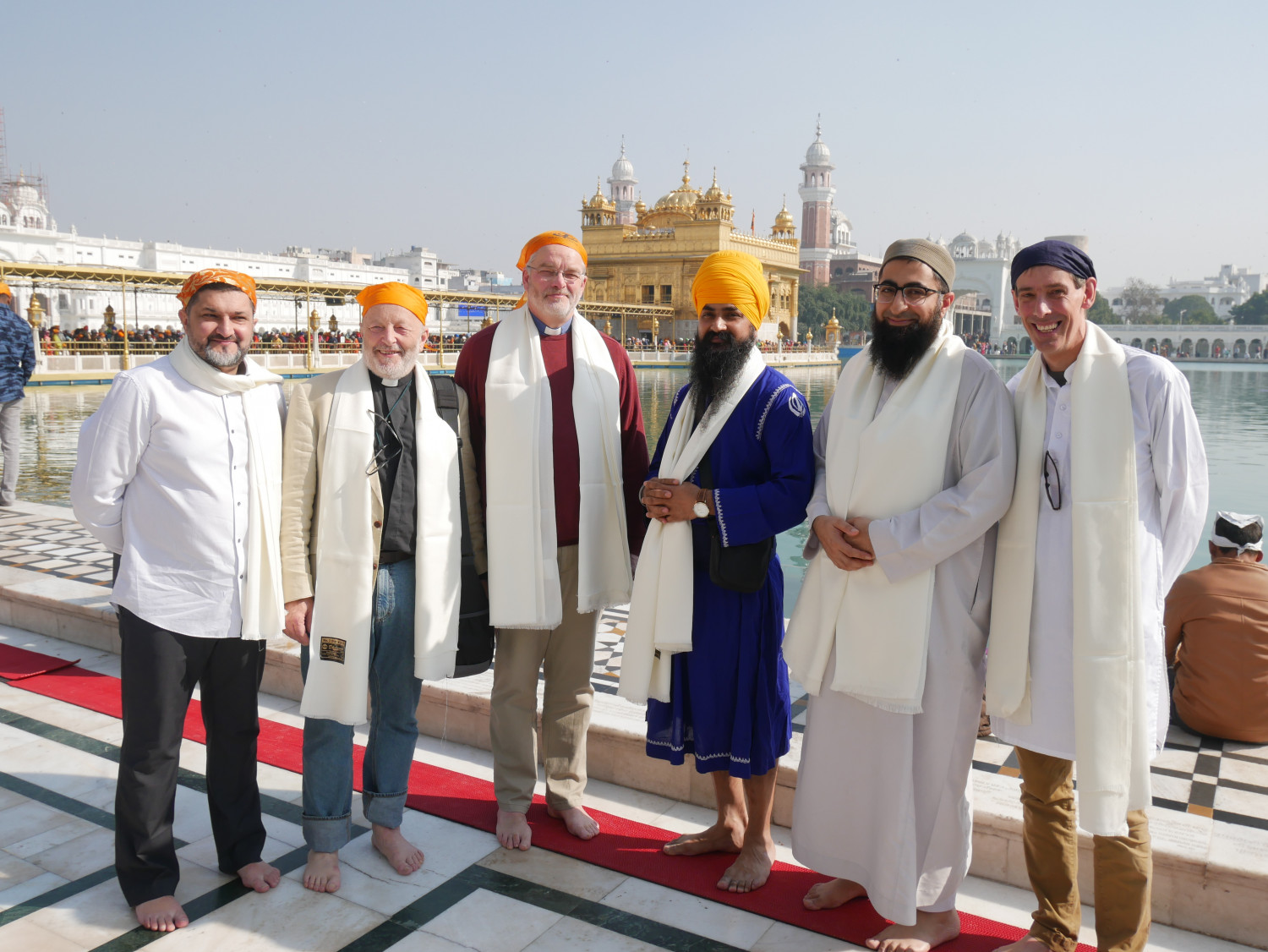 A group of men of different faiths at the Golden Temple in Amritsar