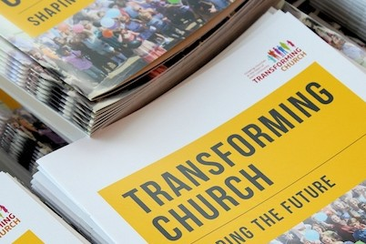 Image of a stack of transforming church booklets