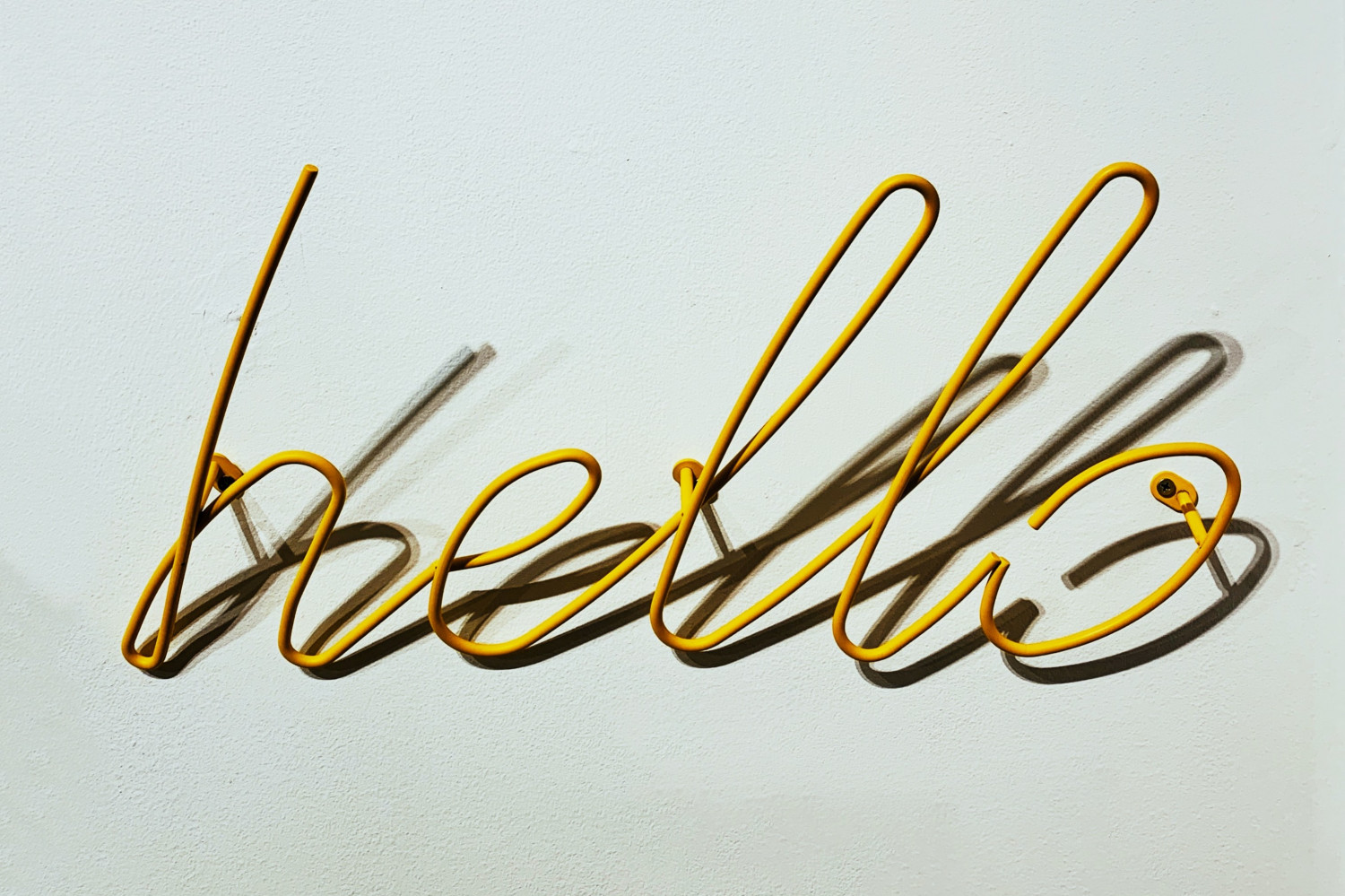 Image of a sign that reads 'hello'