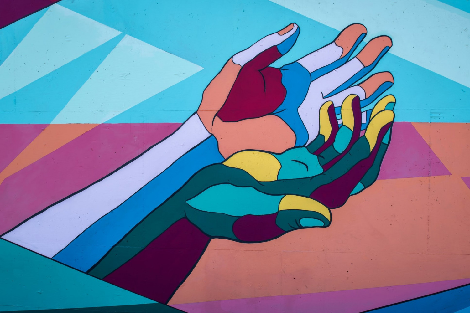 Image of wall mural showing outstretched hands