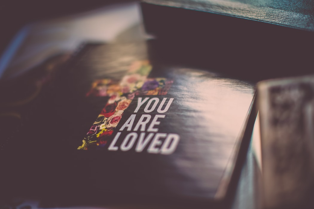 Image of bible with text 'you are loved'