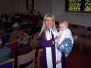 Baby Emily shown to the congregation after baptism