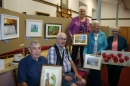 Art group members with their work on display