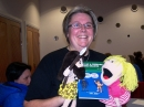 Dawn Walton with her puppets and latest books.