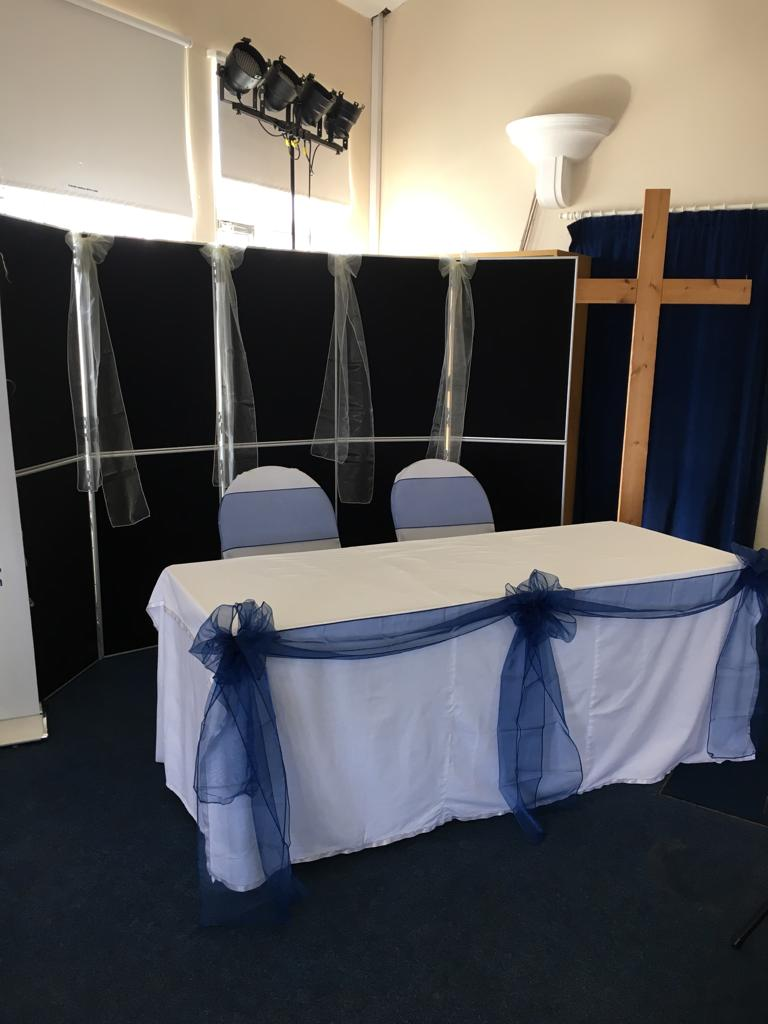Photo of the church register signing table, white table cloth and blue ribbon
