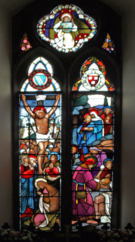 Chancel window depicting the crucifixion and burial of Jesus
