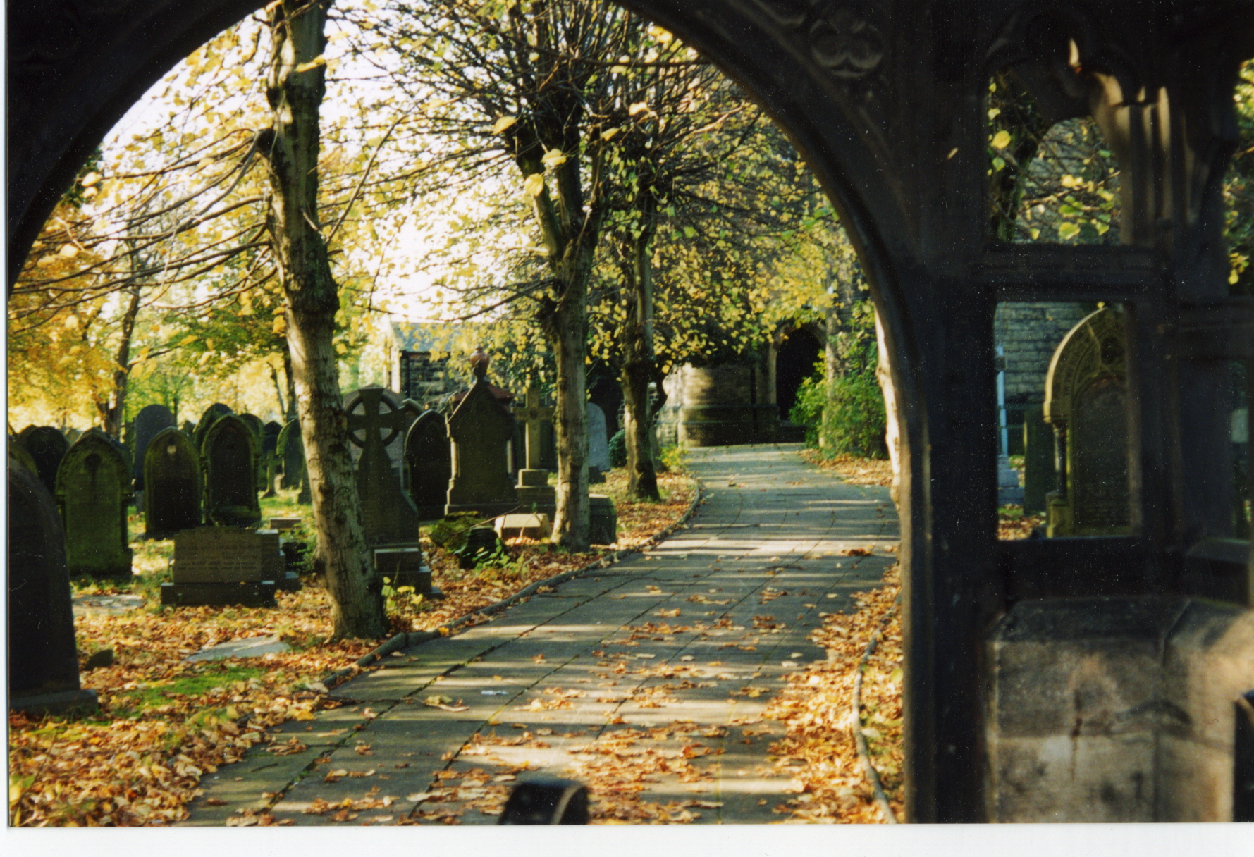 View of lychgate and graveyard