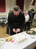 Father Jim cutting the cake