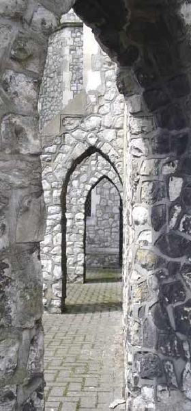Stone arches arond church building