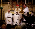 The Bishop blesses the new Priest in Charge