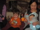 Christingles being held carefully