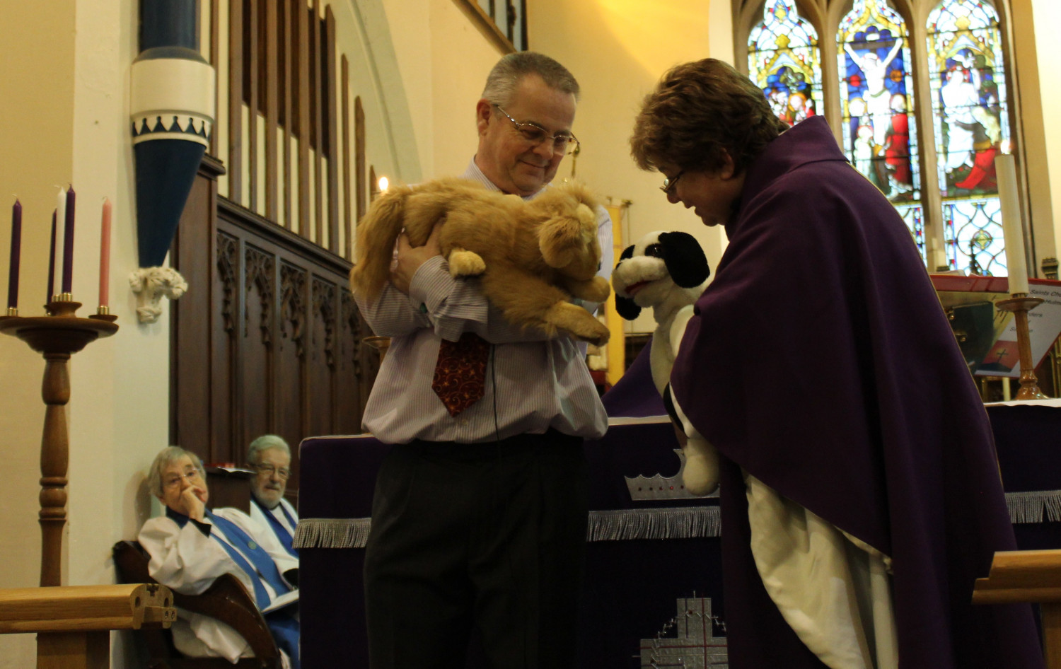 Peter with the new parish pup and Janet Bacon with Abel