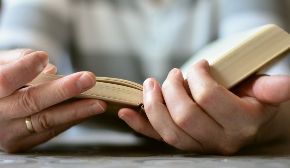 Pictures of hands holding a Bible