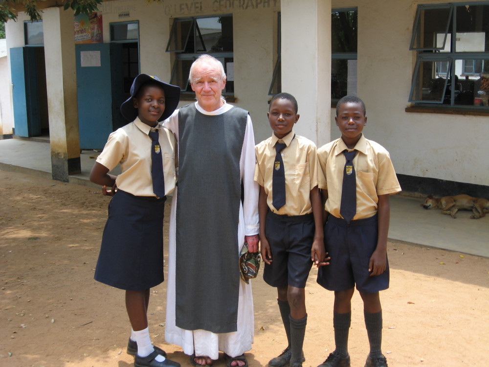 Father Nicolas Stebbing and children supported by Tariro