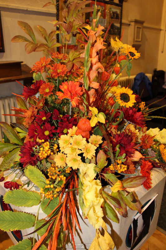 Harvest flowers in the font
