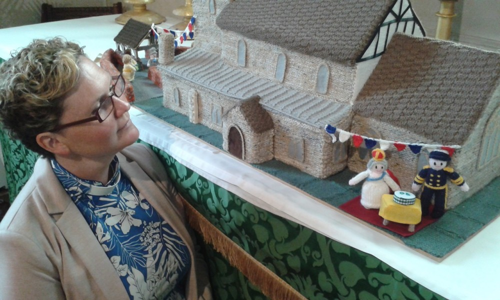 Em Coley with the knitted village