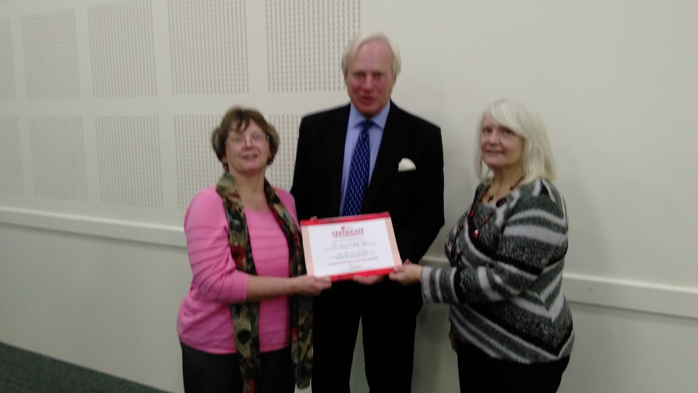 Certificate presentation to Lyndis and Ellie