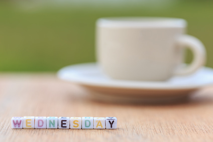 Photo of coffee cup and the word Wednesday spelt out in letter cubes
