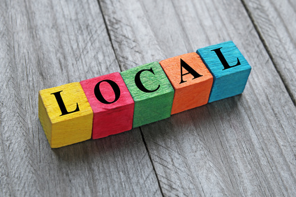 Photo of coloured wooden cubes spelling the word 'Local'.