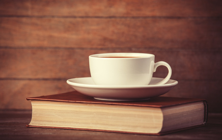 Phpto of a cup and saucer on a Bible