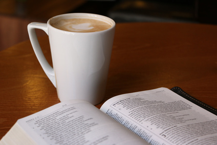 Photo of mug of coffee and an open Bible