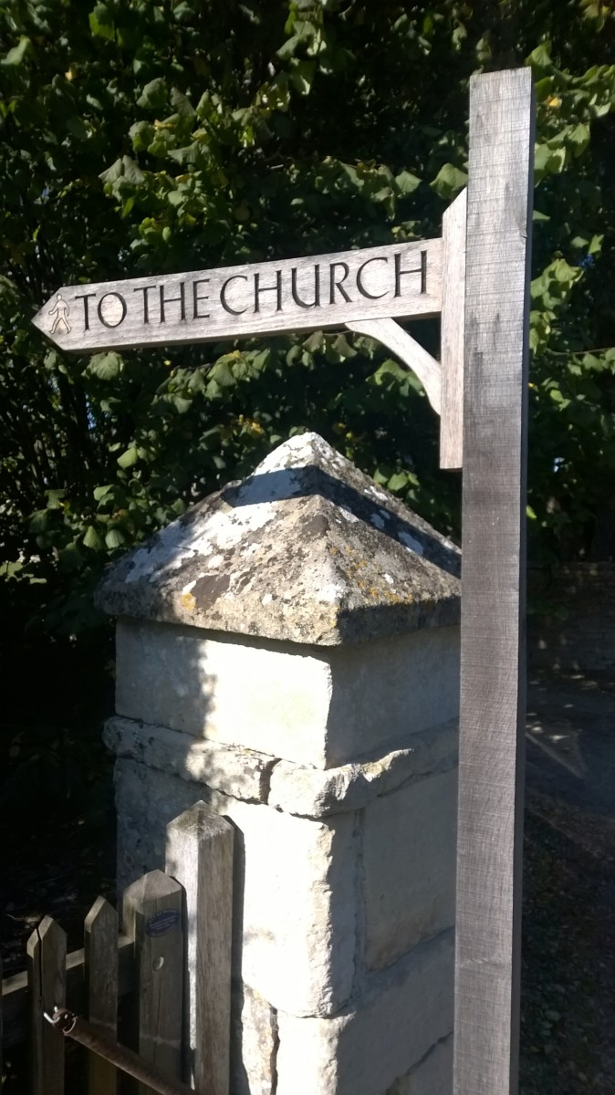 To the church finger post sign