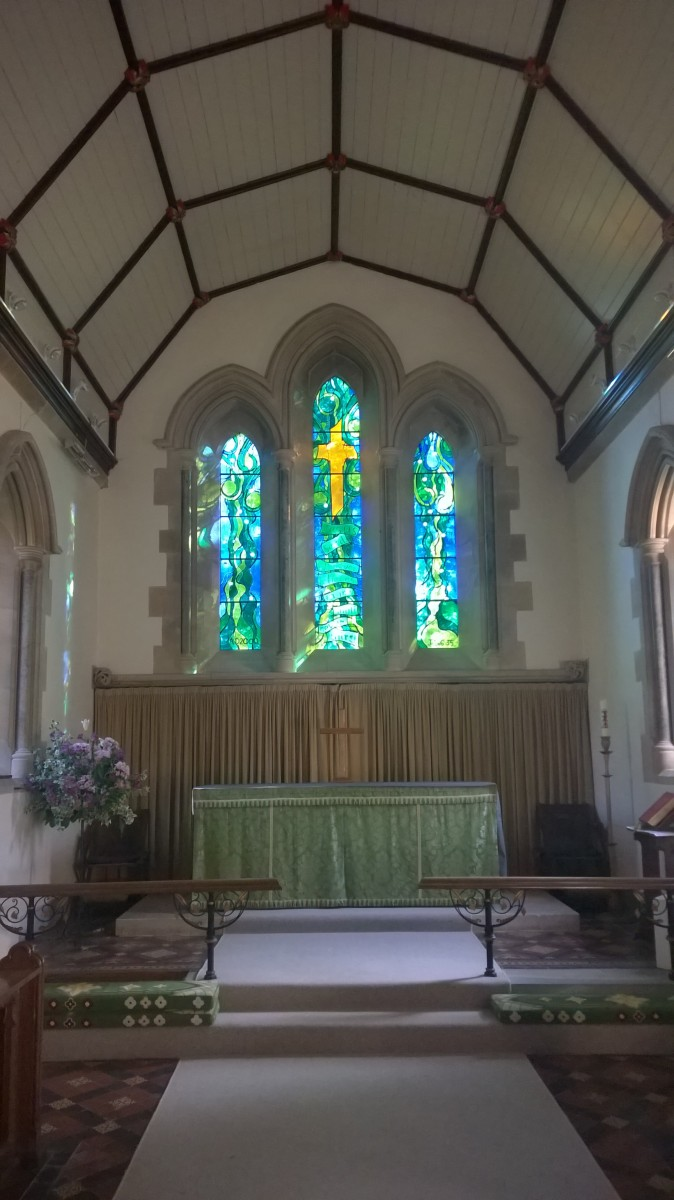 Photo of the Millenium window and altar in All Saint's Kemble