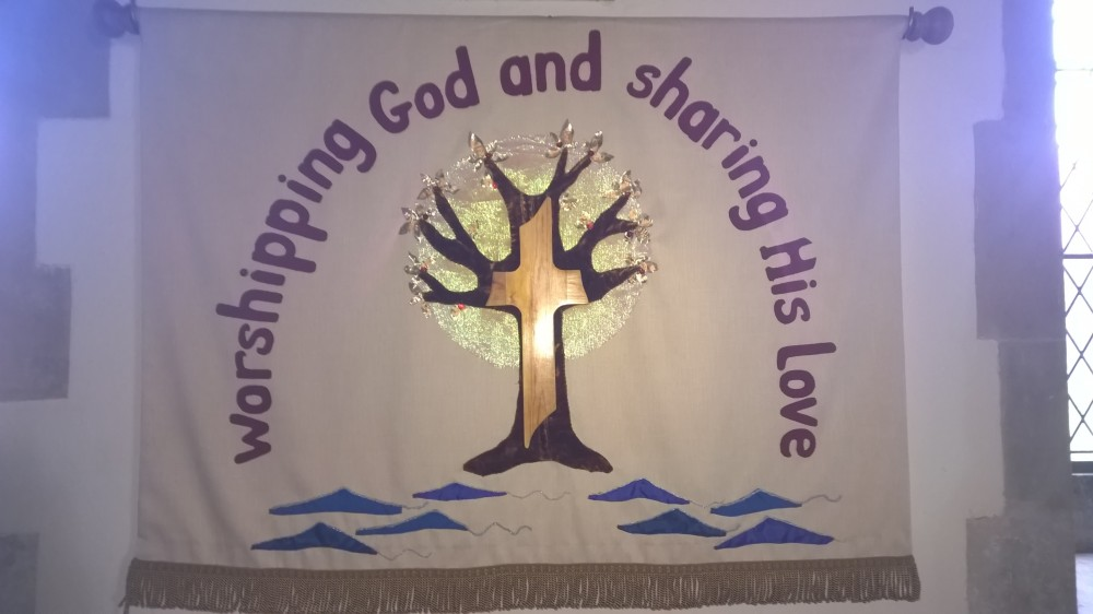 Photo of Banner 'Worshipping God and sharing His love' All Saints Kemble