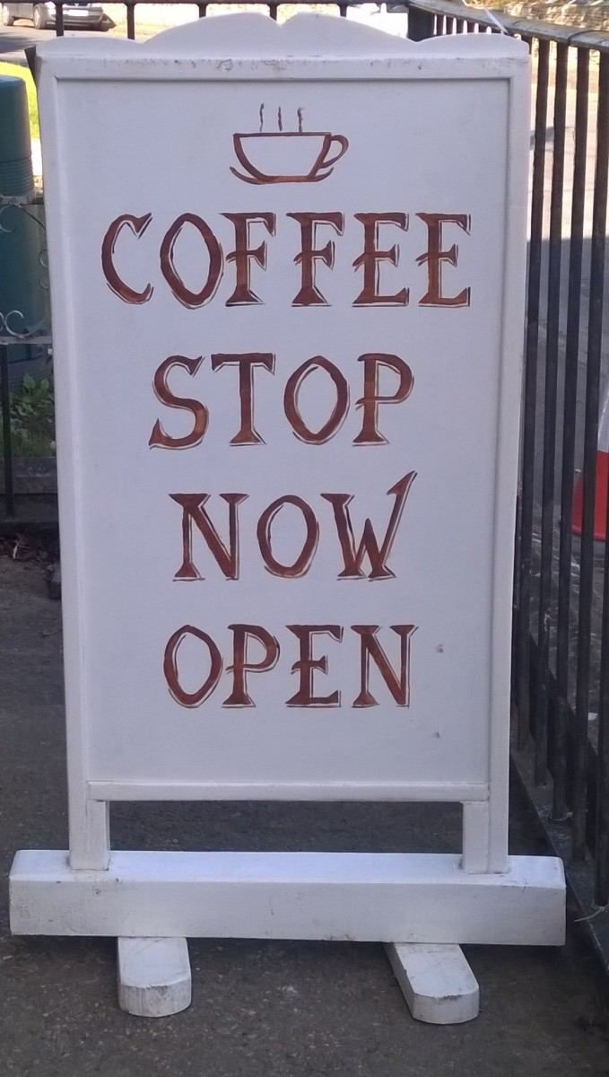 Photo of Sandwich Board showing 'Coffee Stop now open'.