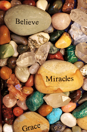 Stones with the words 'Believe' , 'Miracles' and 'Grace'.