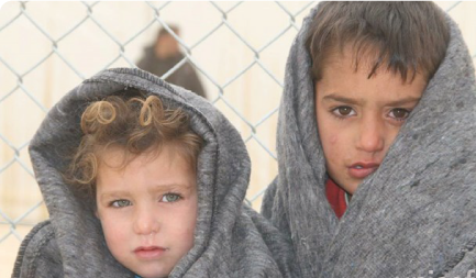 Children wrapped in blankets