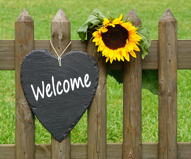 Sunflower and Welcome Sign on gate