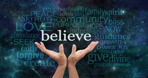 Photo of hands cupped with the word Believe and other associated words coming from them.
