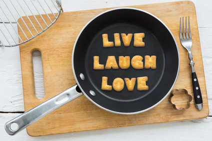Frying pan with fried bread spelling 'Live, laugh. love'