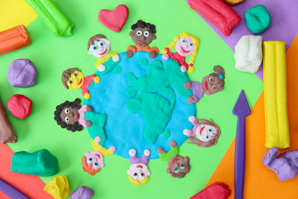 Photo of plasticine model of young children around a table.