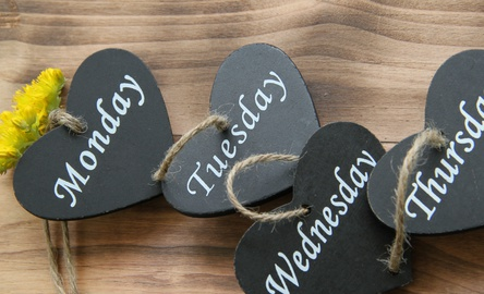 Photo of mini slate hearts with the names of days of the week written on them.