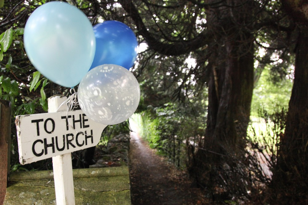 Photo of Finger post with the words 'To the Church'.
