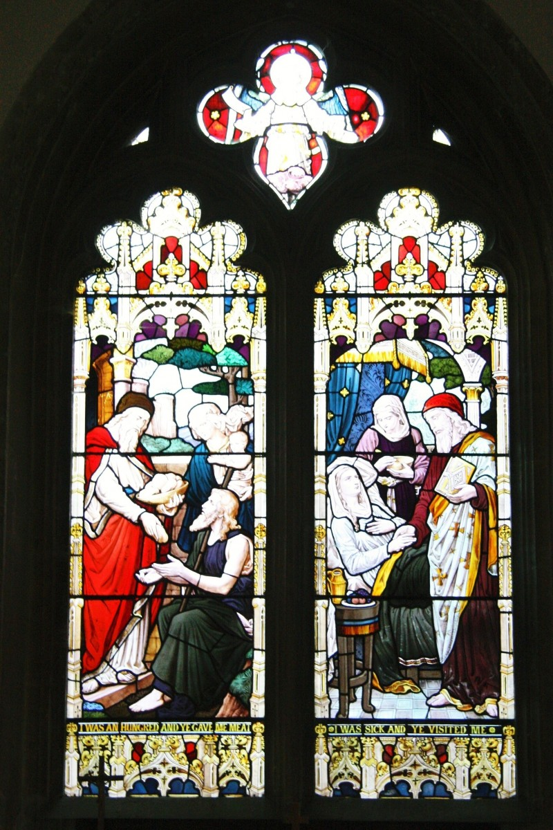 North aisle east end window Westbourne church shows pictures of charity