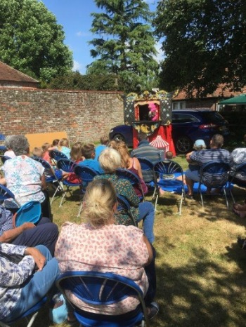 Crowd watchng Punch and Judy show at church fete 2019