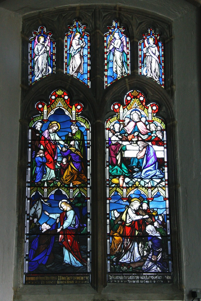 Chancel window on the north side showing four scenes from life of Jesus